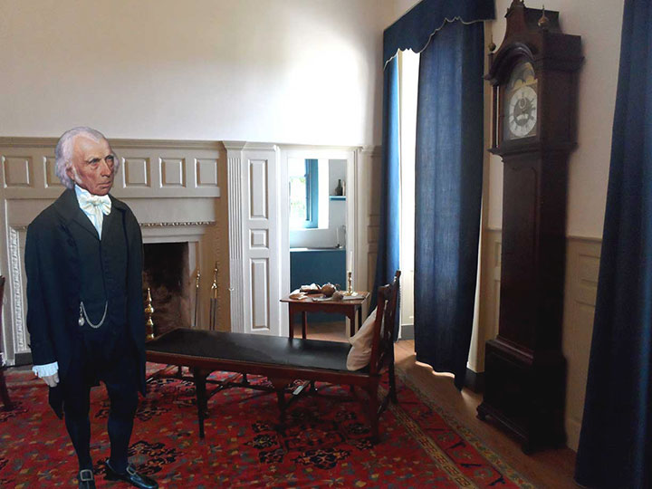 James Madison in Nelly Madison's room looking at his father's clock.